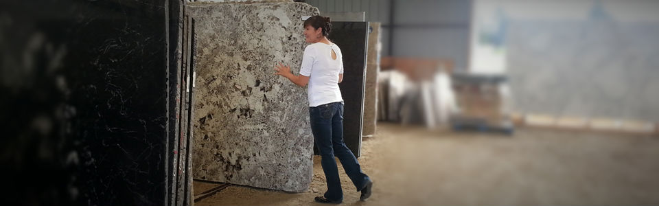 woman looking at granite slab